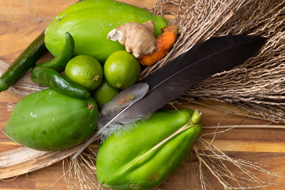 green papayas with lime, chili, ginger, turmeric