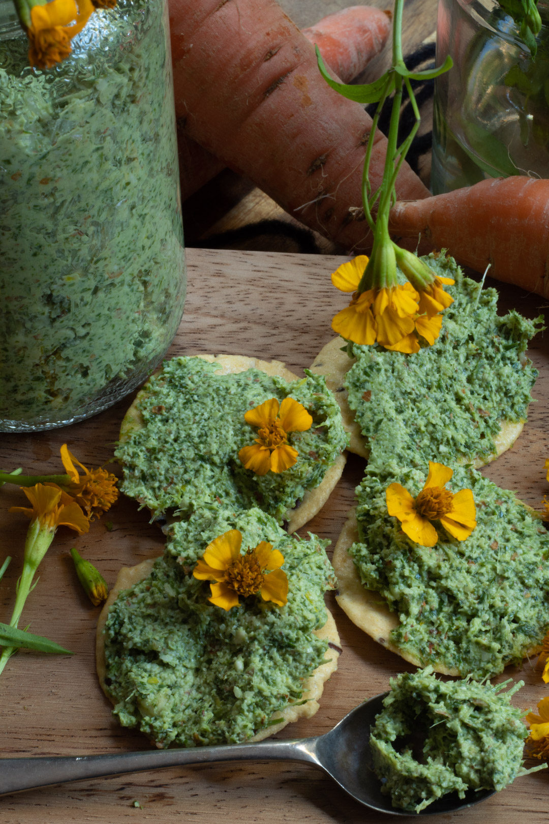 carrot top pesto crackers flat lay
