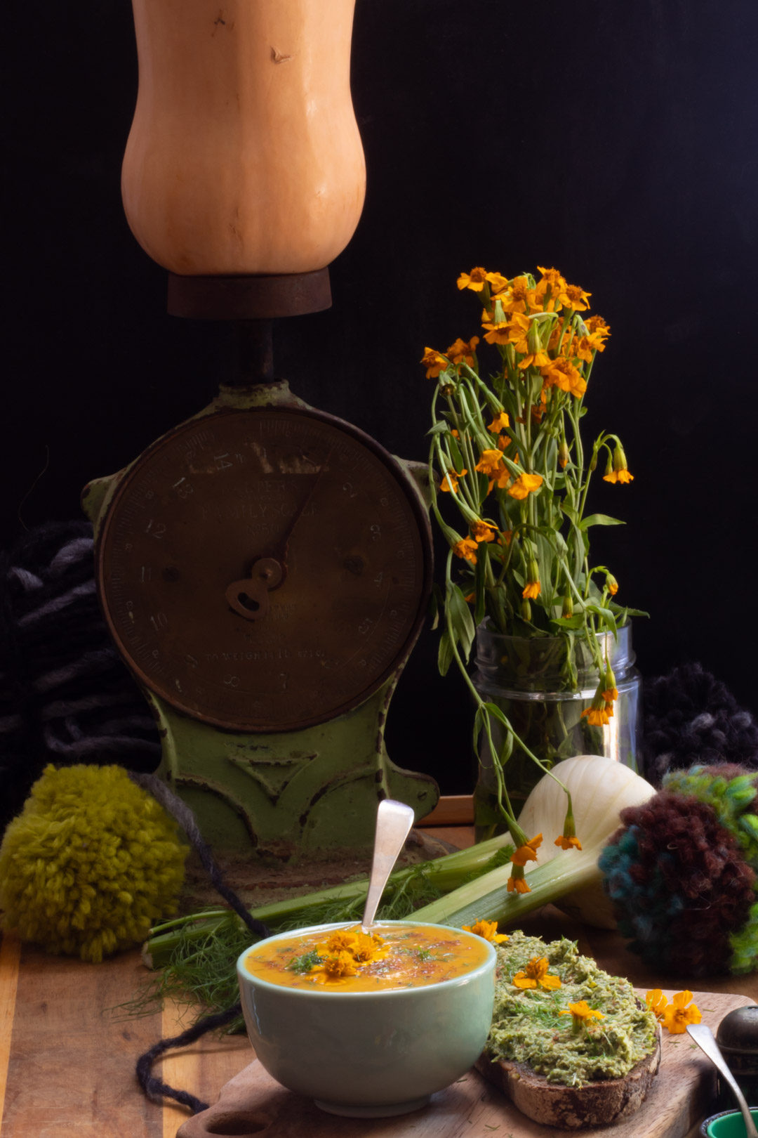 carrot and fennel soup with tarragon, fennel tops and nutmeg with antique kitchen scale