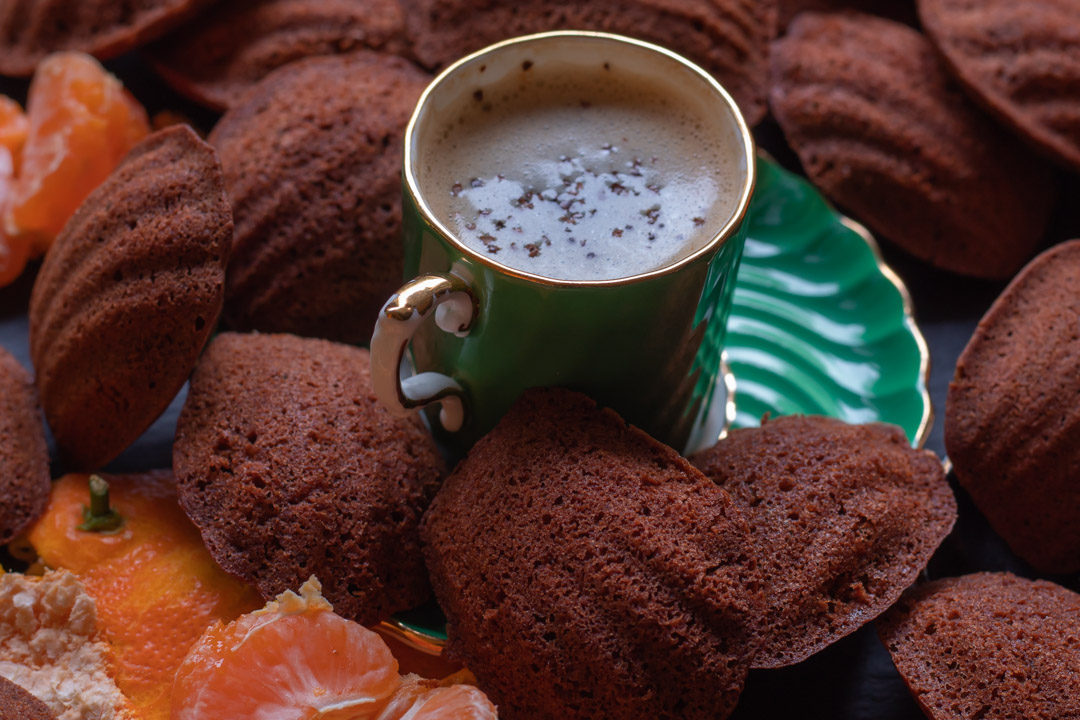 madeleines with mandarin, raw cacao and wattlseed green cup