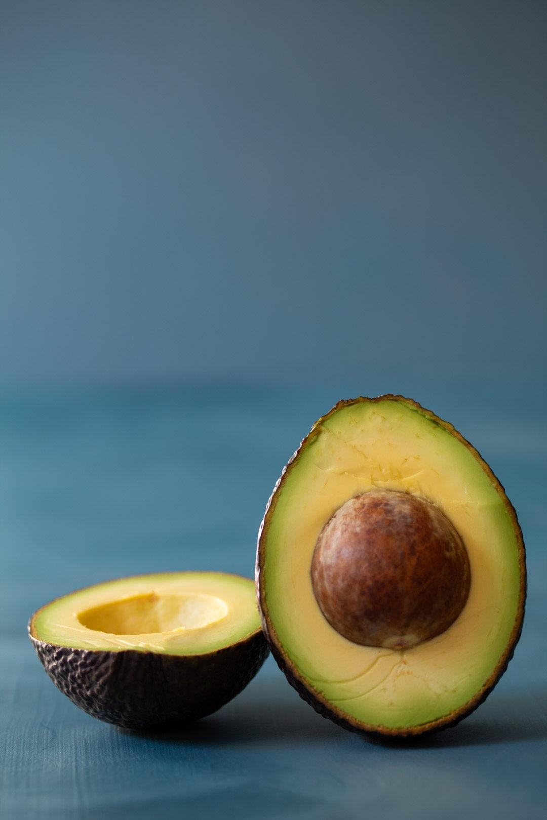 avocado still life halved