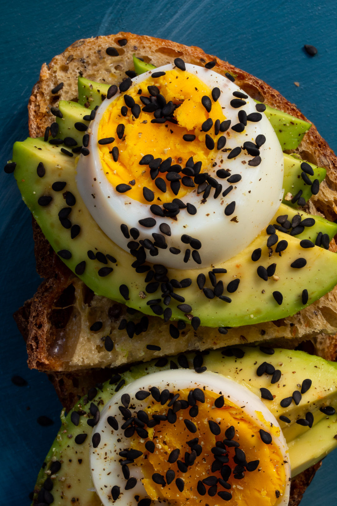 avocado toasts with hard boiled eggs close up