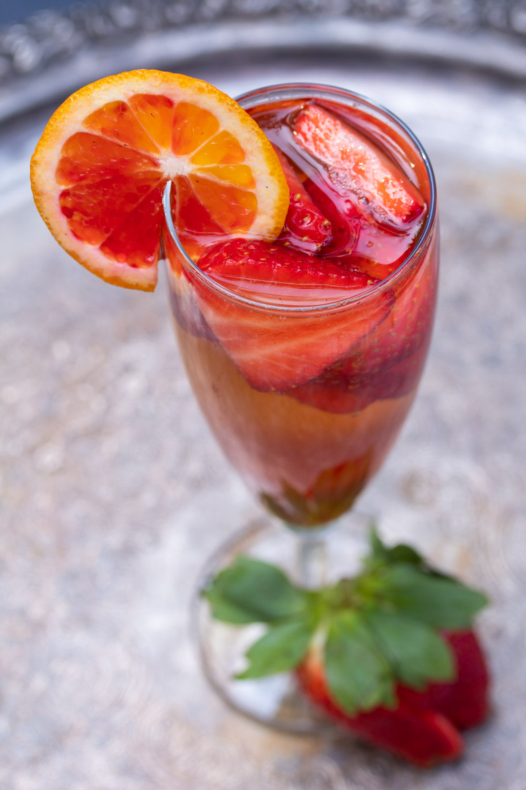 blood orange shrub and strawberry champagne cocktail
