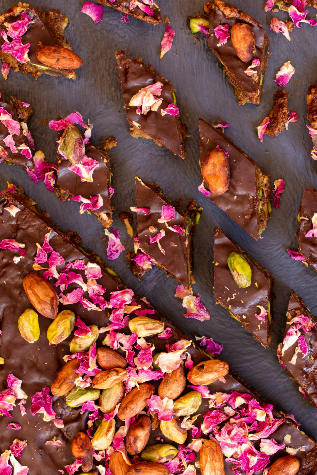 Spiced raw cacao halva with pistachios, ginger, cardamom and rose: cut round from above