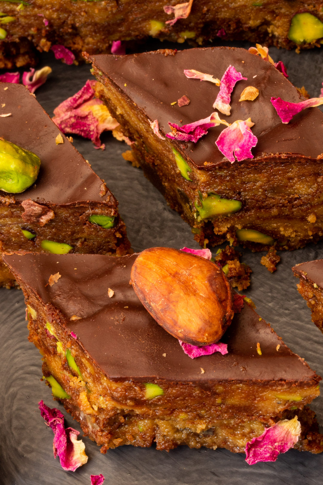Spiced raw cacao halva with pistachios, ginger, cardamom and rose: diamond pieces close up