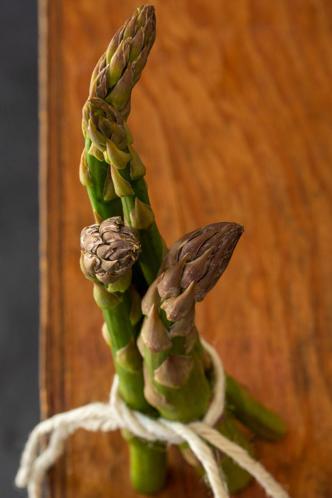 asparagus & lemon tart: asparagus still life on wooden box
