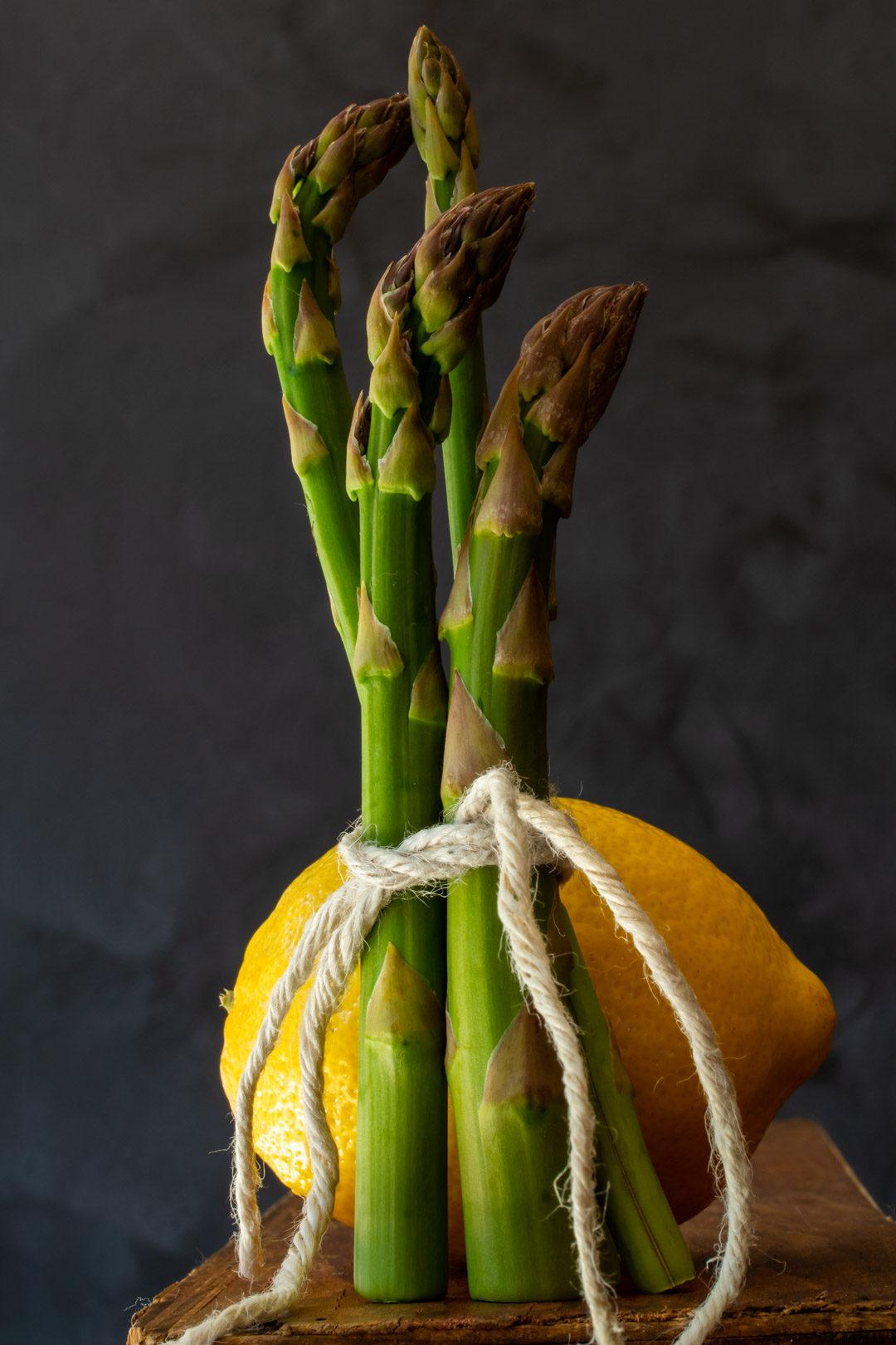 asparagus & lemon tart: asparagus and lemon still life on wooden box