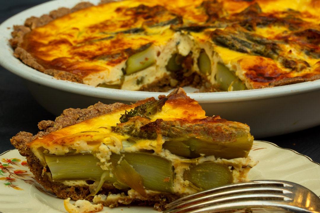 asparagus & lemon tart: slice with whole tart in background