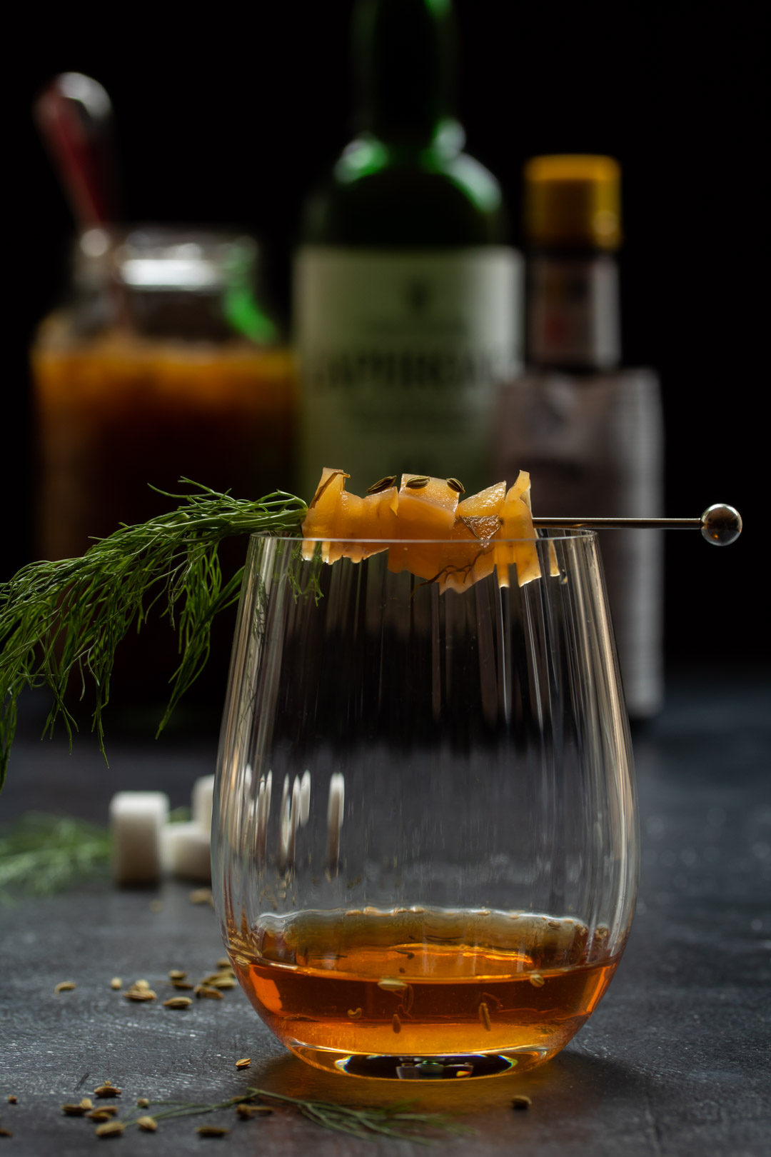 fennel pickle old fashioned cocktail: eye level making vertical