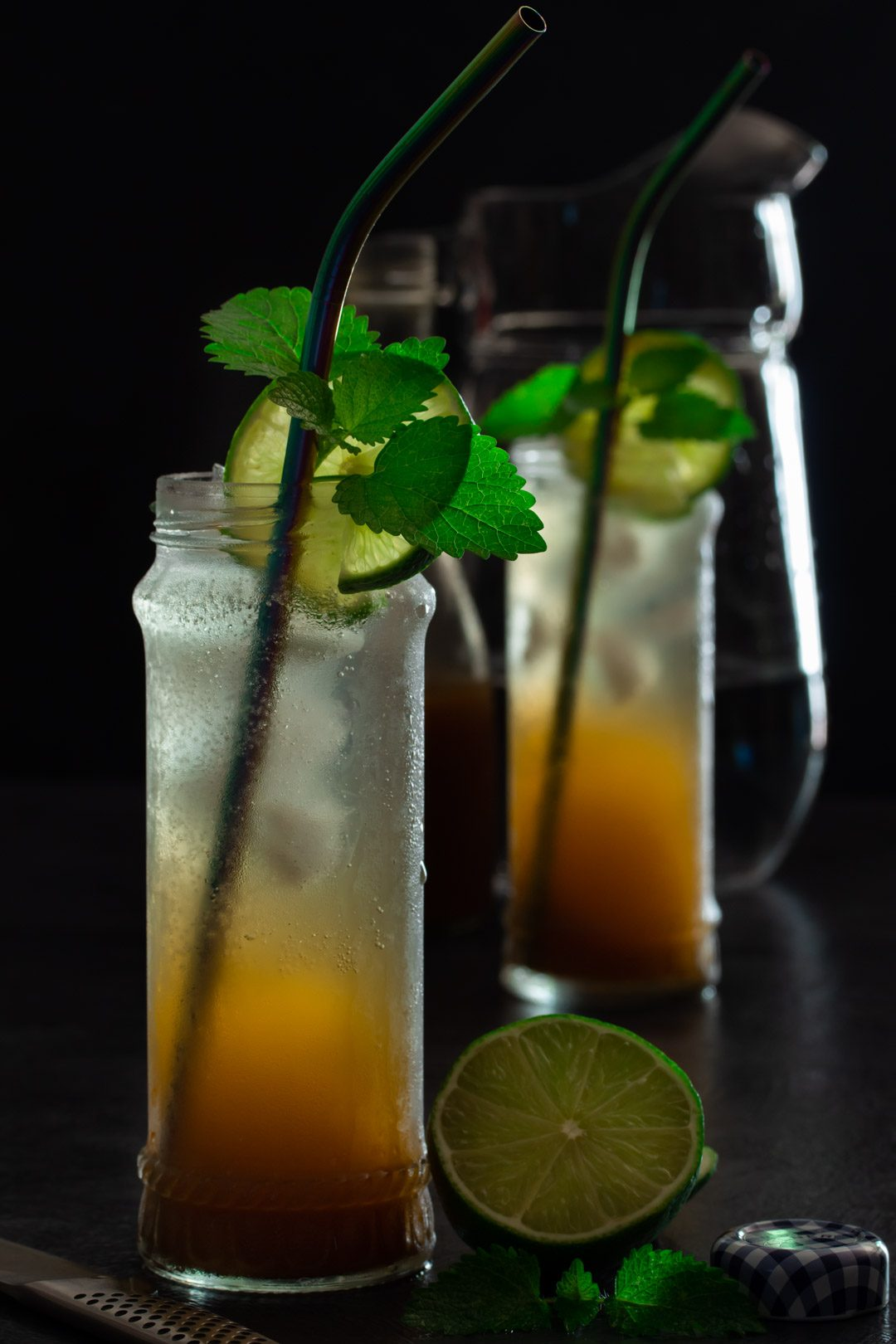 Ginger lime shrub syrup drinking vinegar: jug and bottle in background
