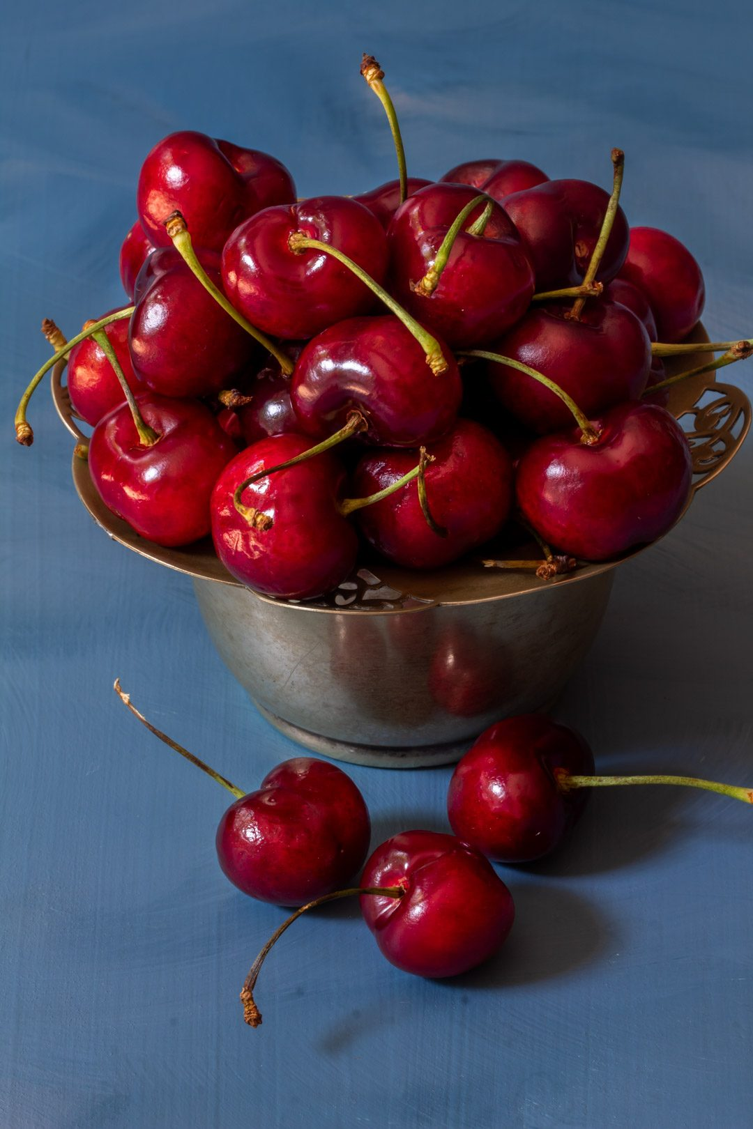 Making spiced pickled cherries with cherries in vintage sugar bowl from 45 degrees