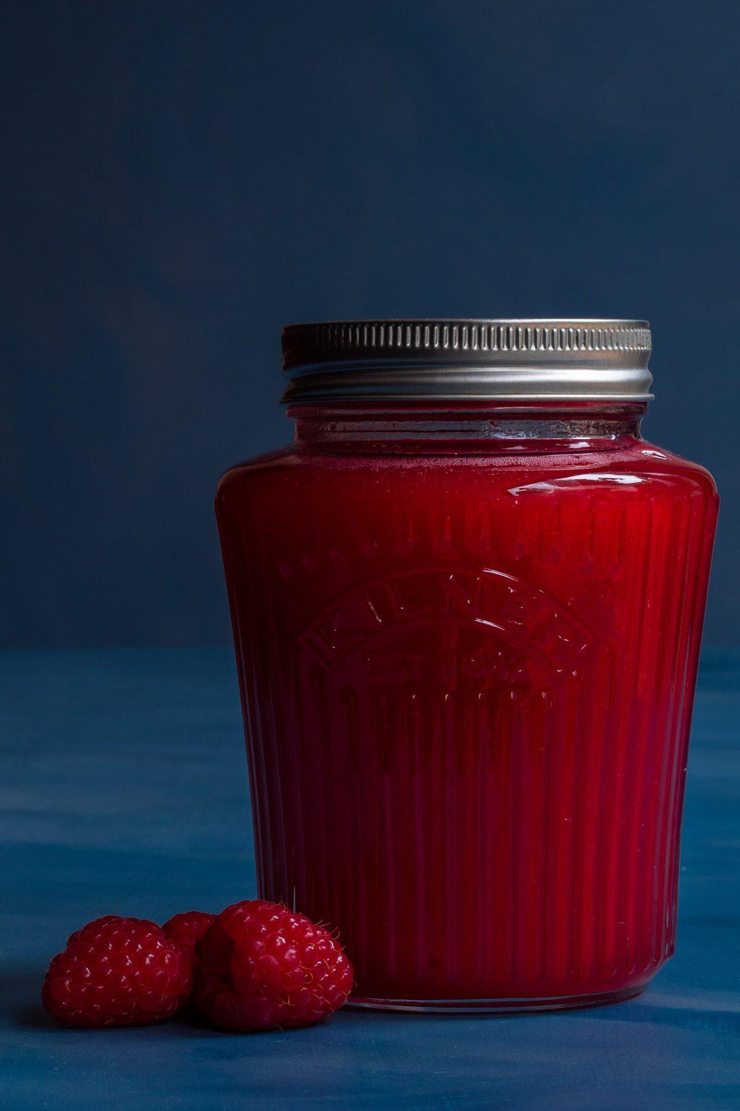Raspberry shrub syrup drinking vinegar in vintage style preserving jar