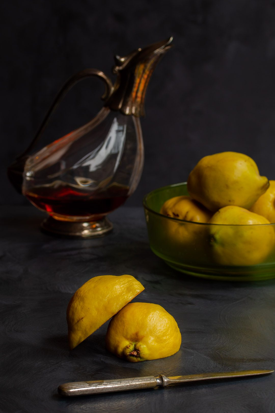 Making Vintage Quince Cordial cut quince in foreground