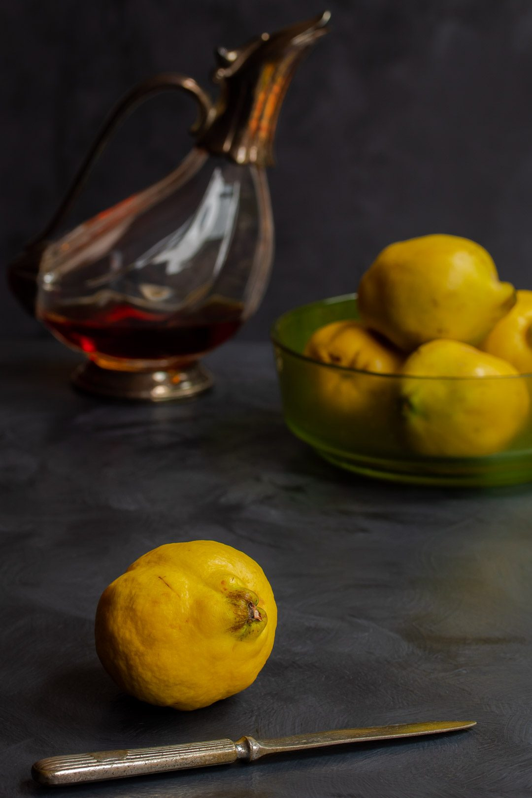 Making Vintage Quince Cordial single quince in foreground
