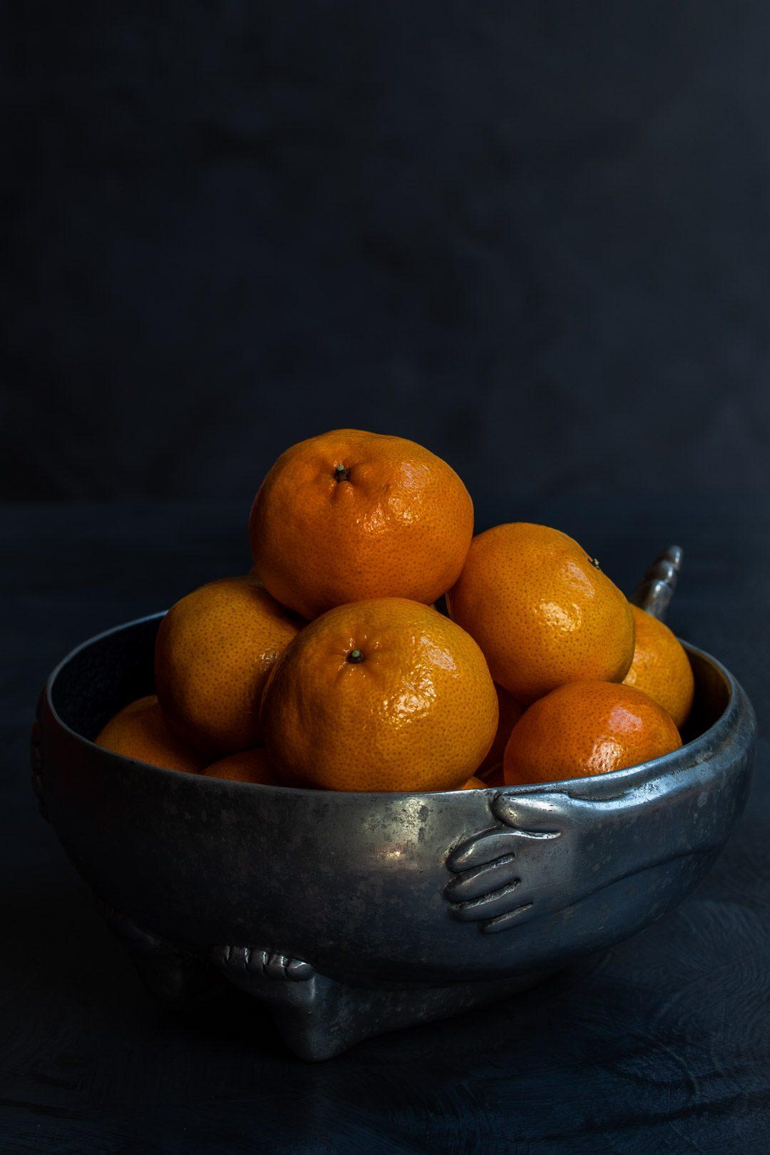 Making Mandarin tarragon shrub syrup drinking vinegar with mandarins in metal bowl