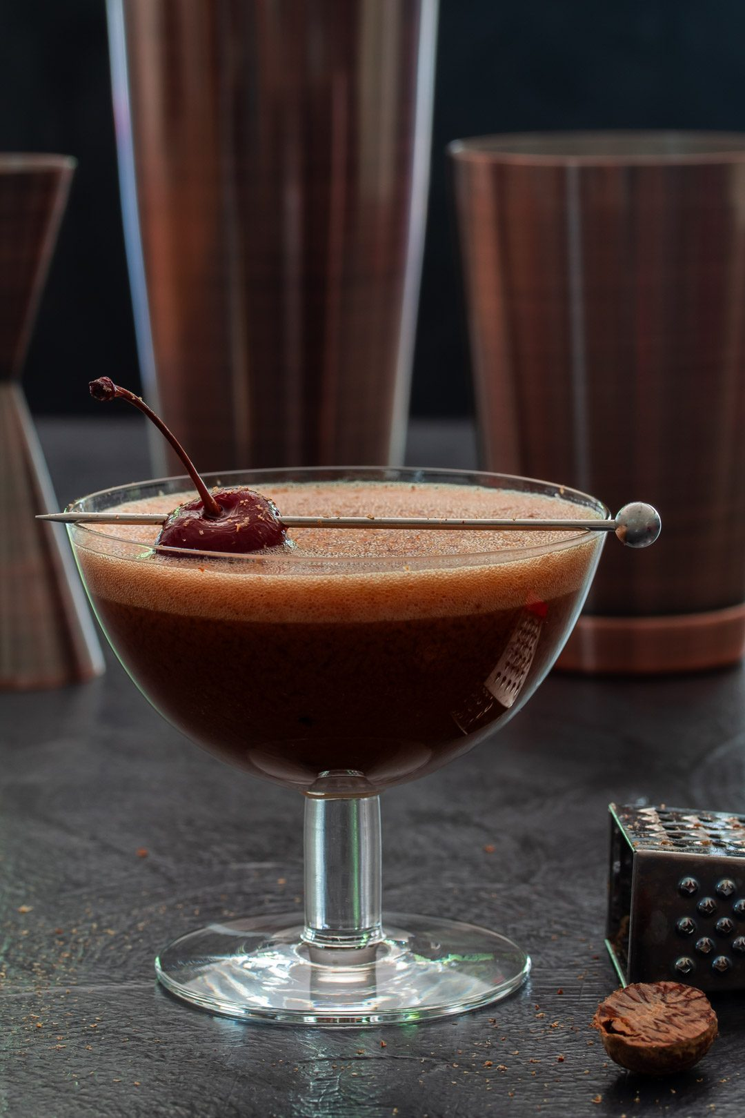 Pickled cherry chocolate sherry flip cocktail with Boston shakers