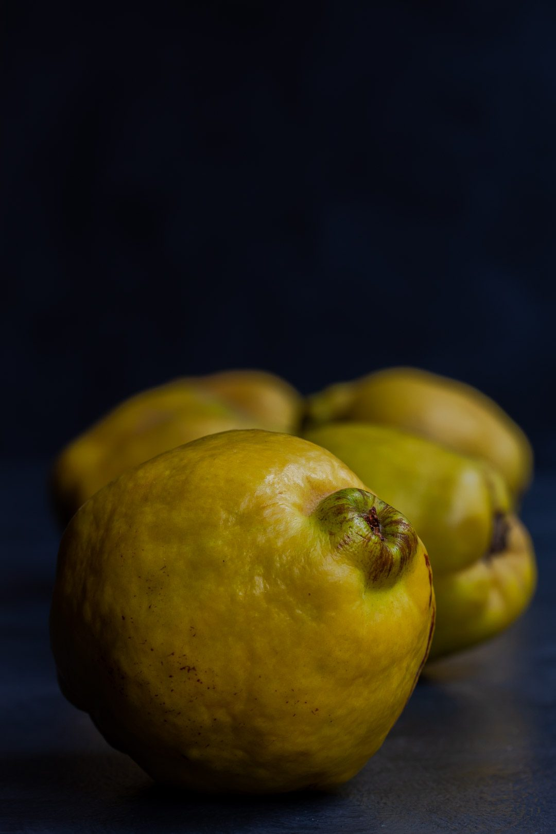 Making Vintage Quince Cordial with quinces in a row centred