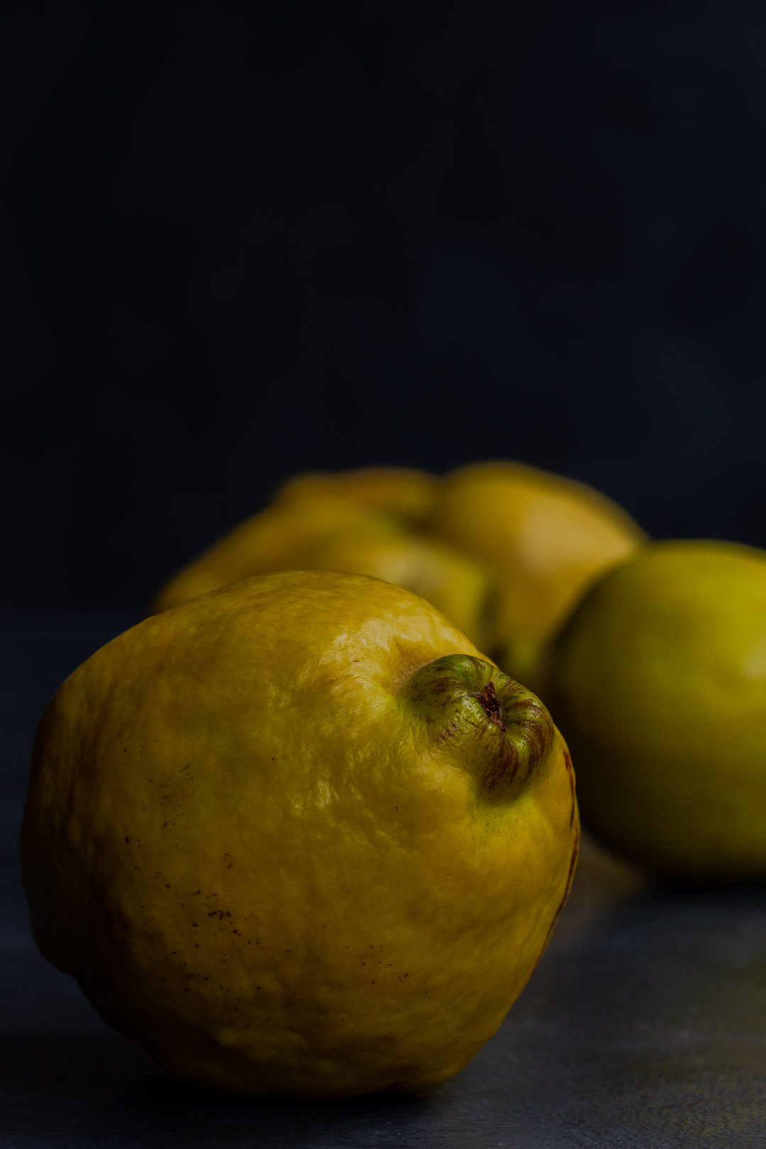Making Vintage Quince Cordial with quinces in a row front one to left of centre