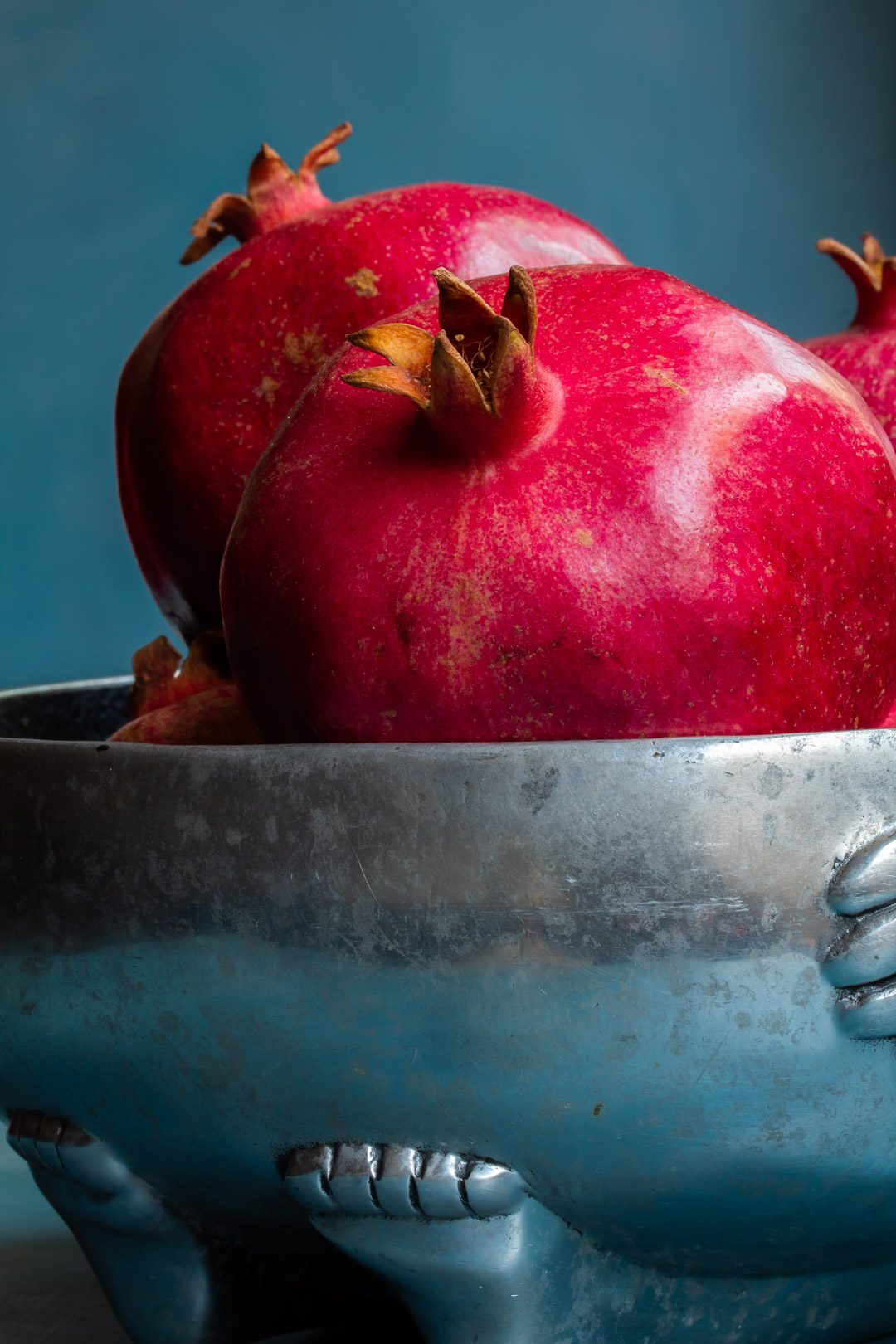 pomegranates in metal bowl close up used to make grenadine