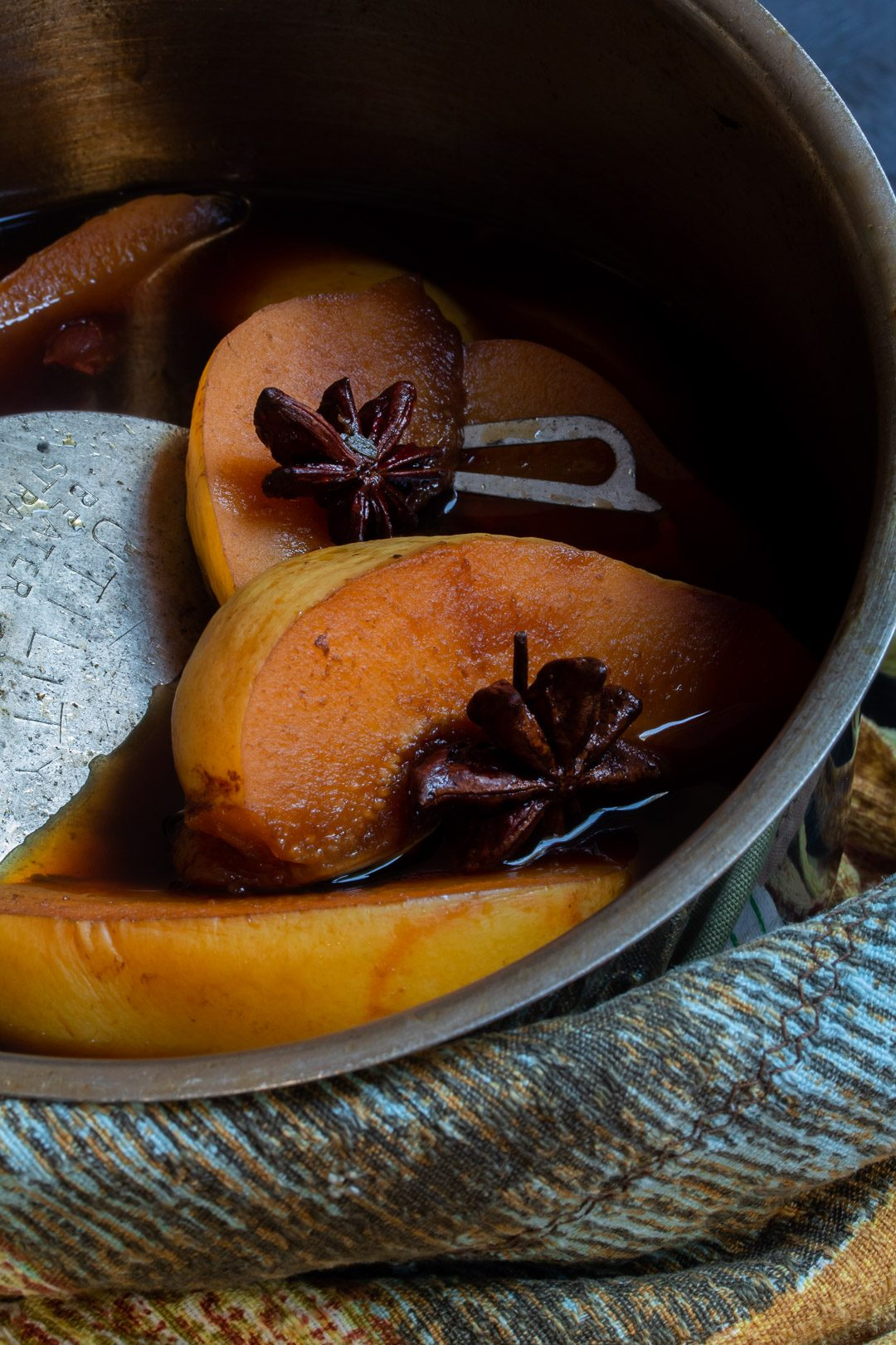 Spiced pickled quinces in saucepan