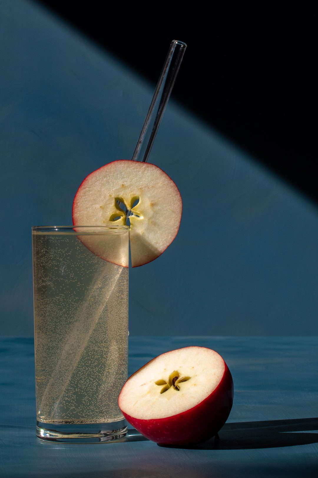 apple shrub gin fizz cocktail with shadows and lines close up
