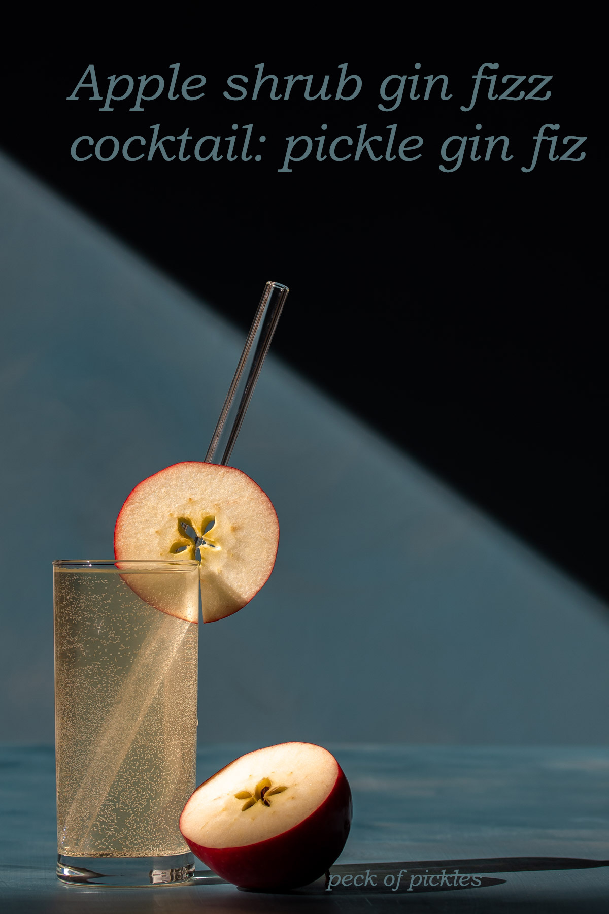 apple shrub gin fizz cocktail or pickle gin fiz on a blue background with hard light and shadows