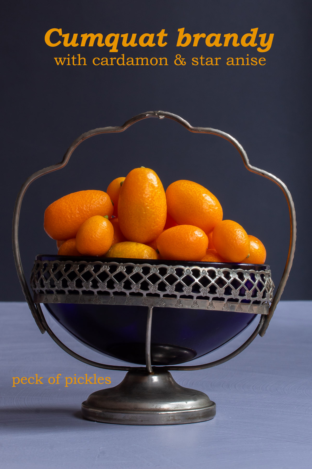 making cumquat brandy with cumquats in vintage glass sugar bowl