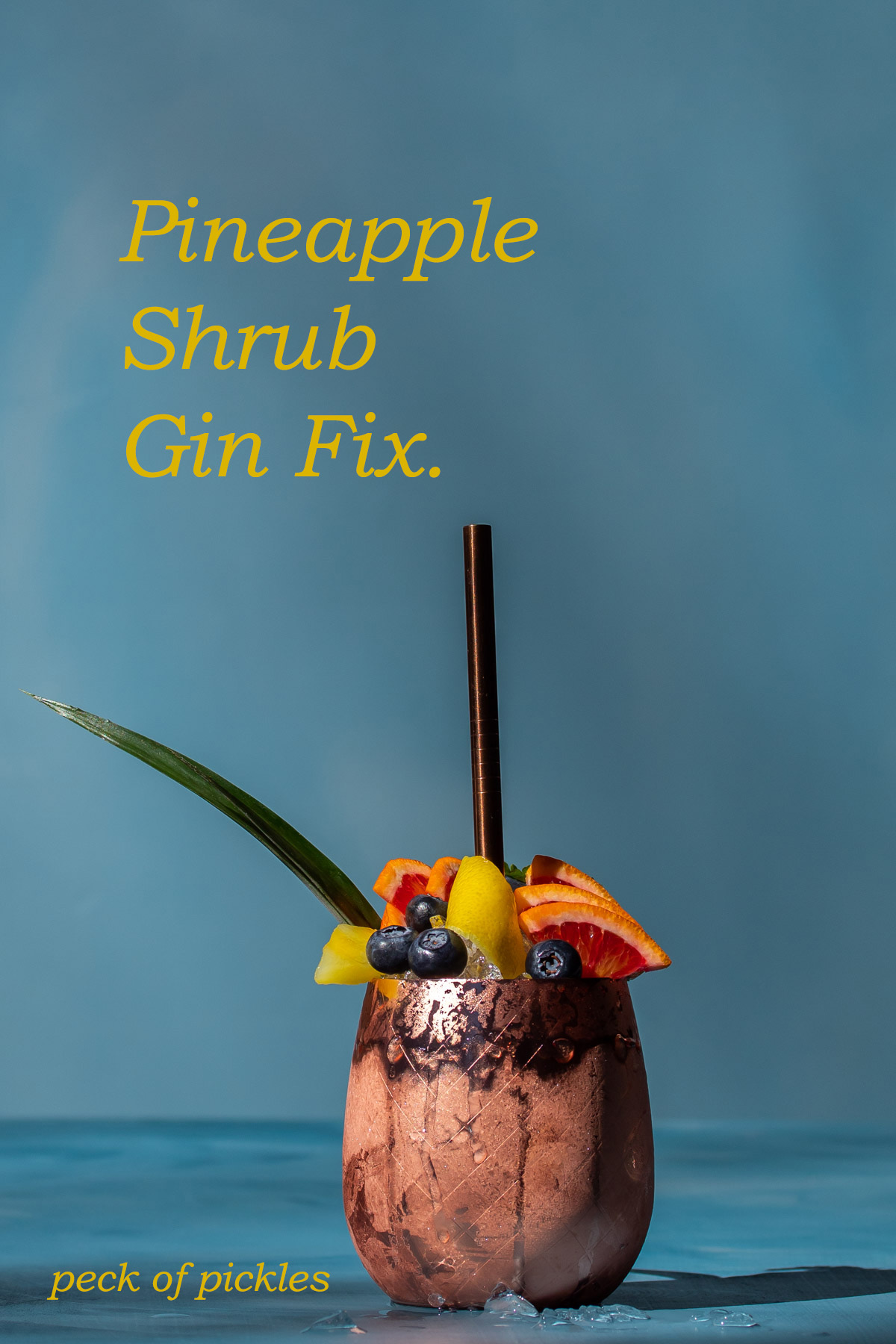 pineapple shrub gin fix cocktail isolated on blue background