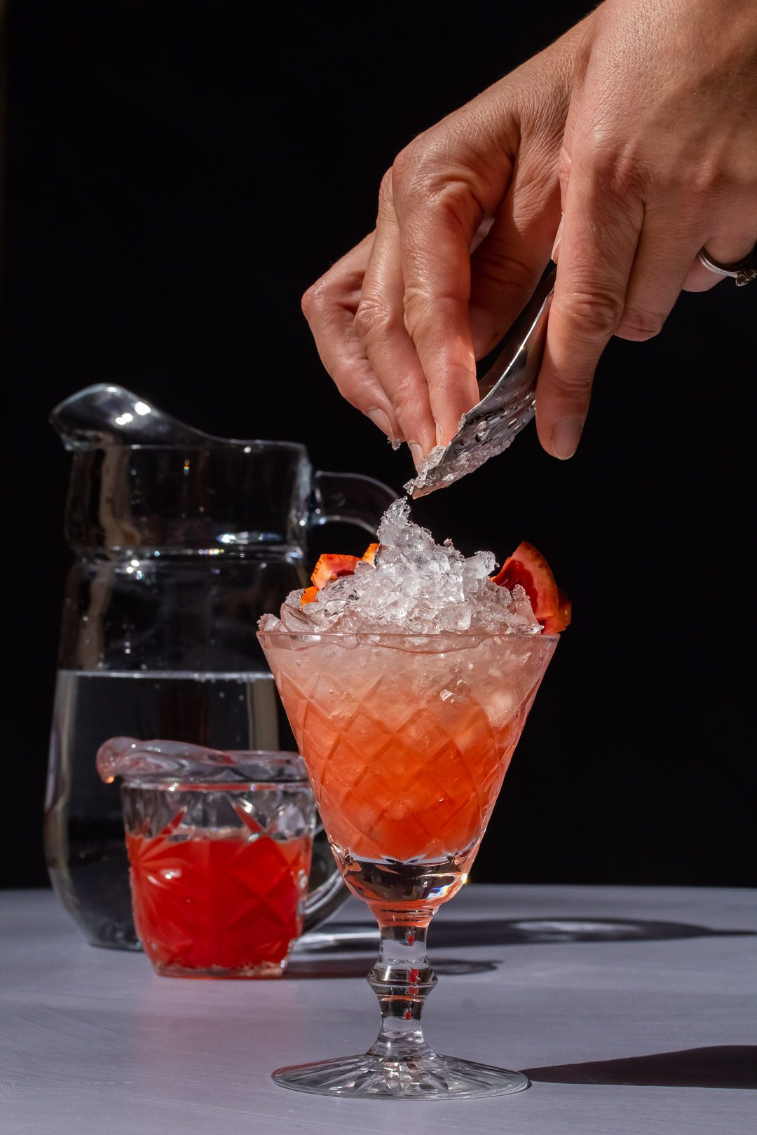 tipping ice onto improved strawberry shrub