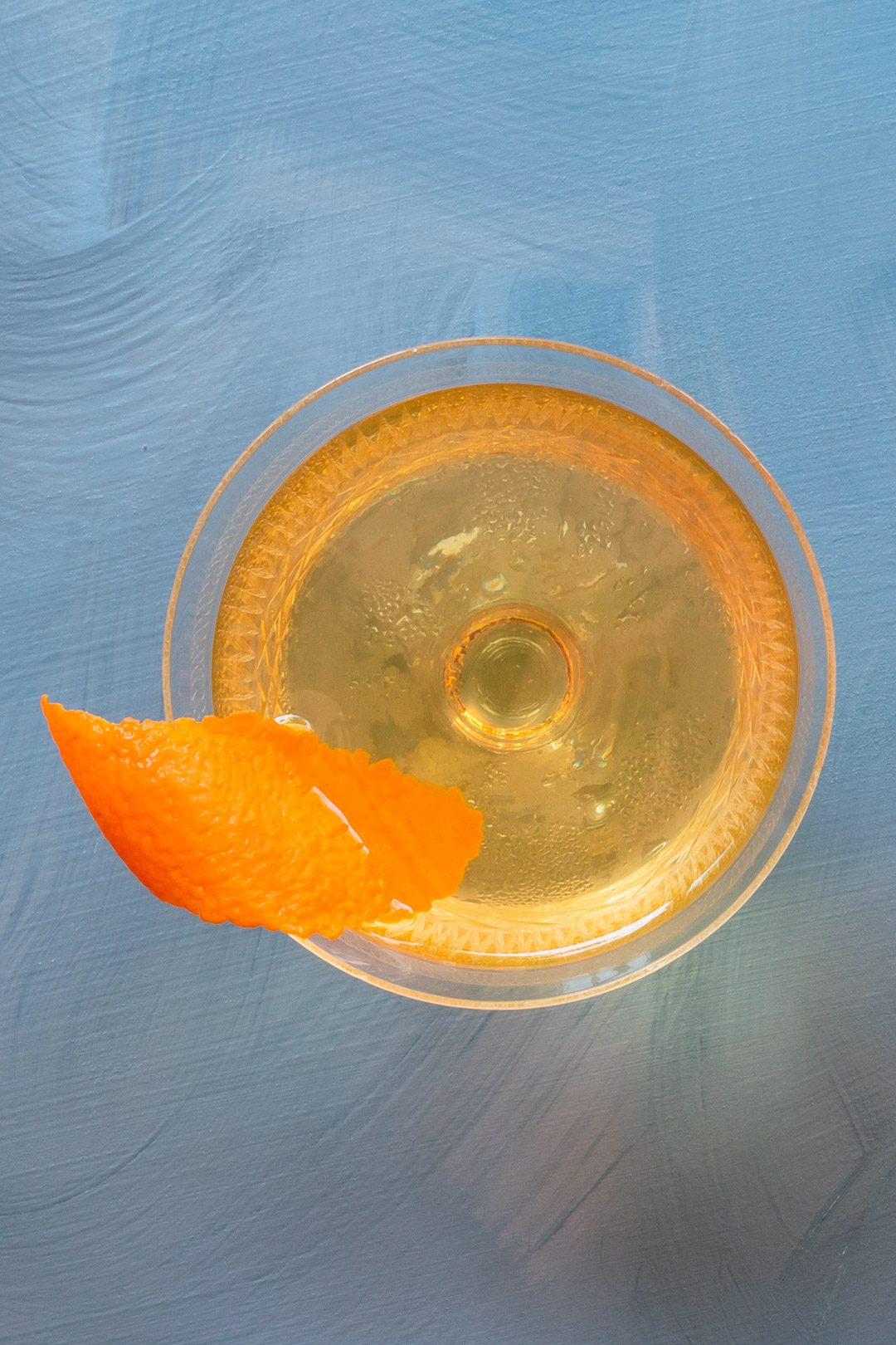 rose lavender dry martini from above on blue background