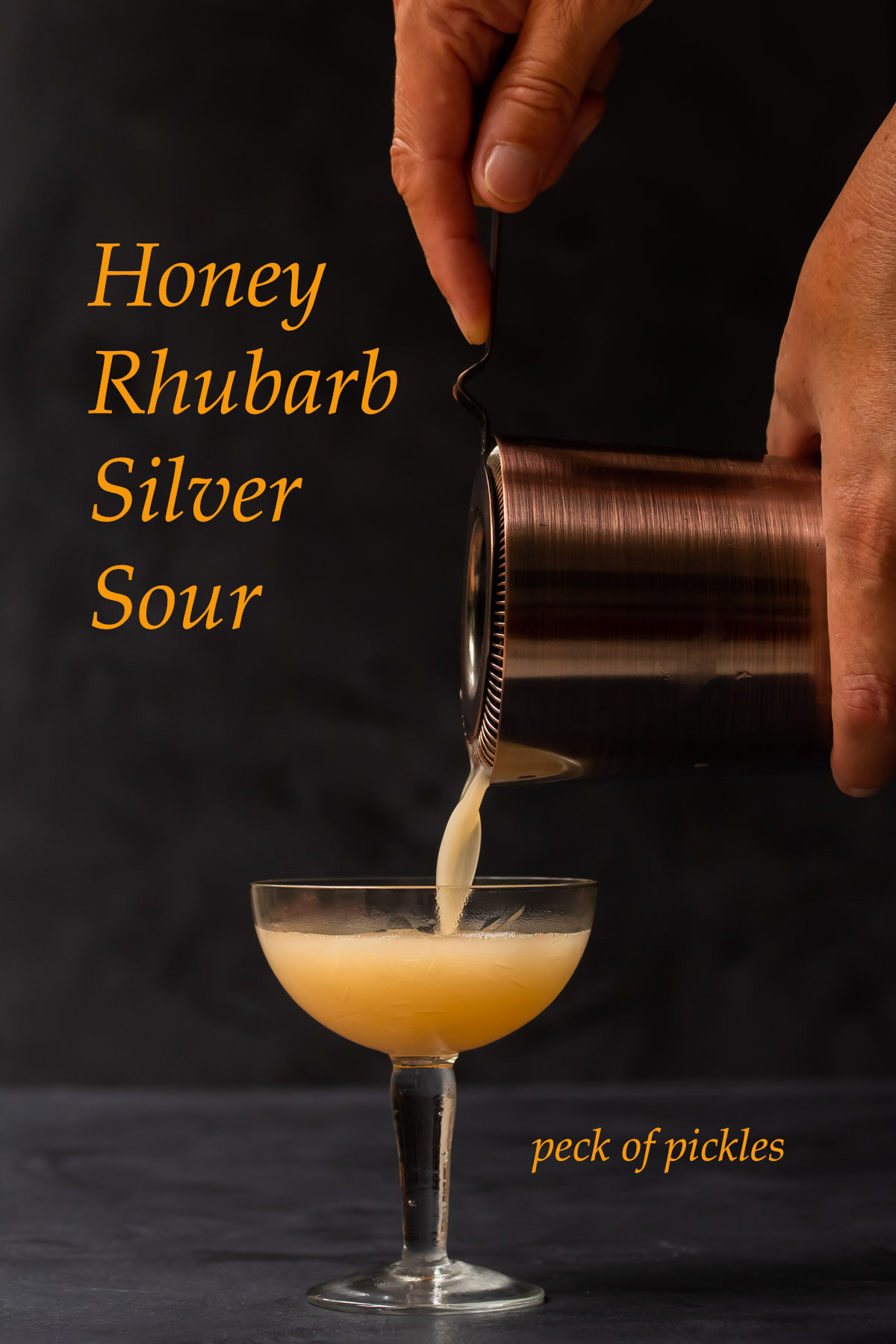 pouring honey rhubarb silver sour glass 2/3 full