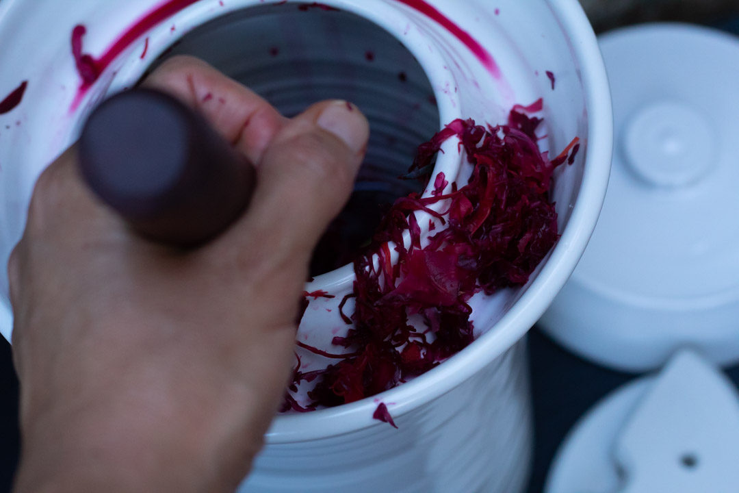 spiced beetroot sauerkraut with fermenting pot and mallet
