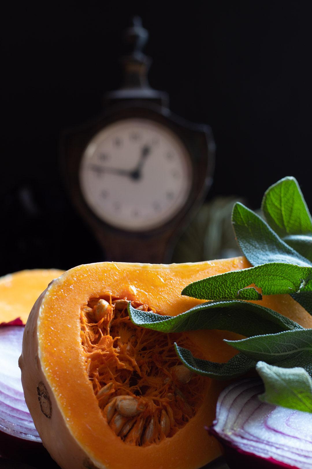 cut pumpkin with clock