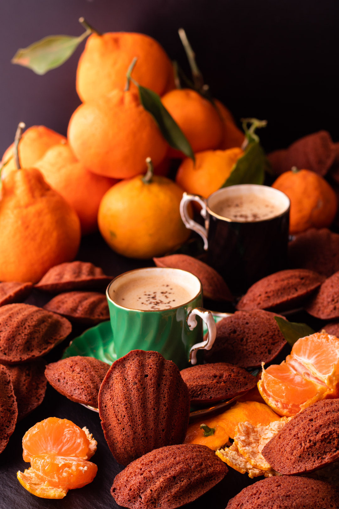 madeleines with mandarin, raw cacao and wattleseed served with wattleseed coffee and fresh mandarins
