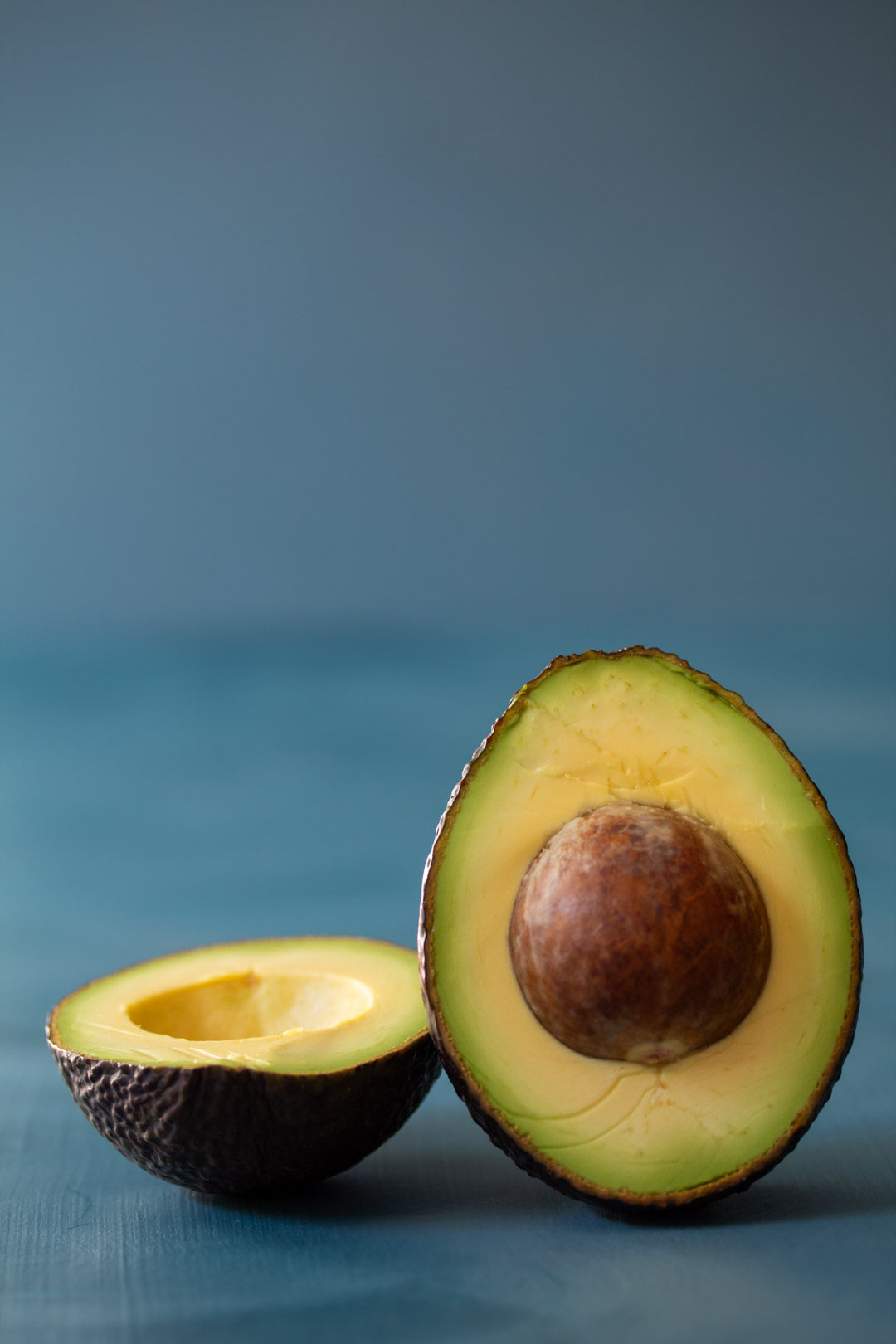 avocado still life halved