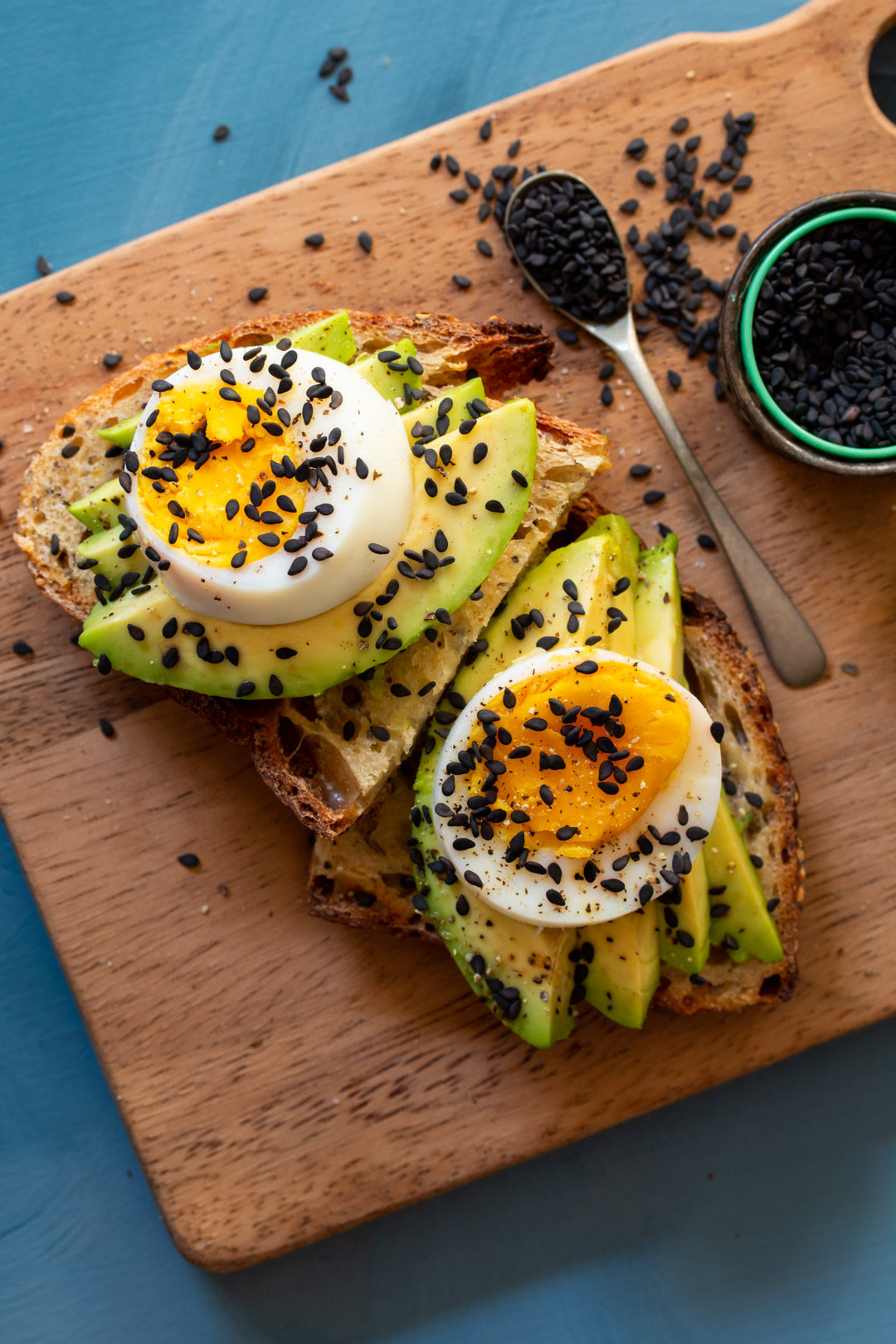 avocado toasts with hard boiled eggs on chopping board