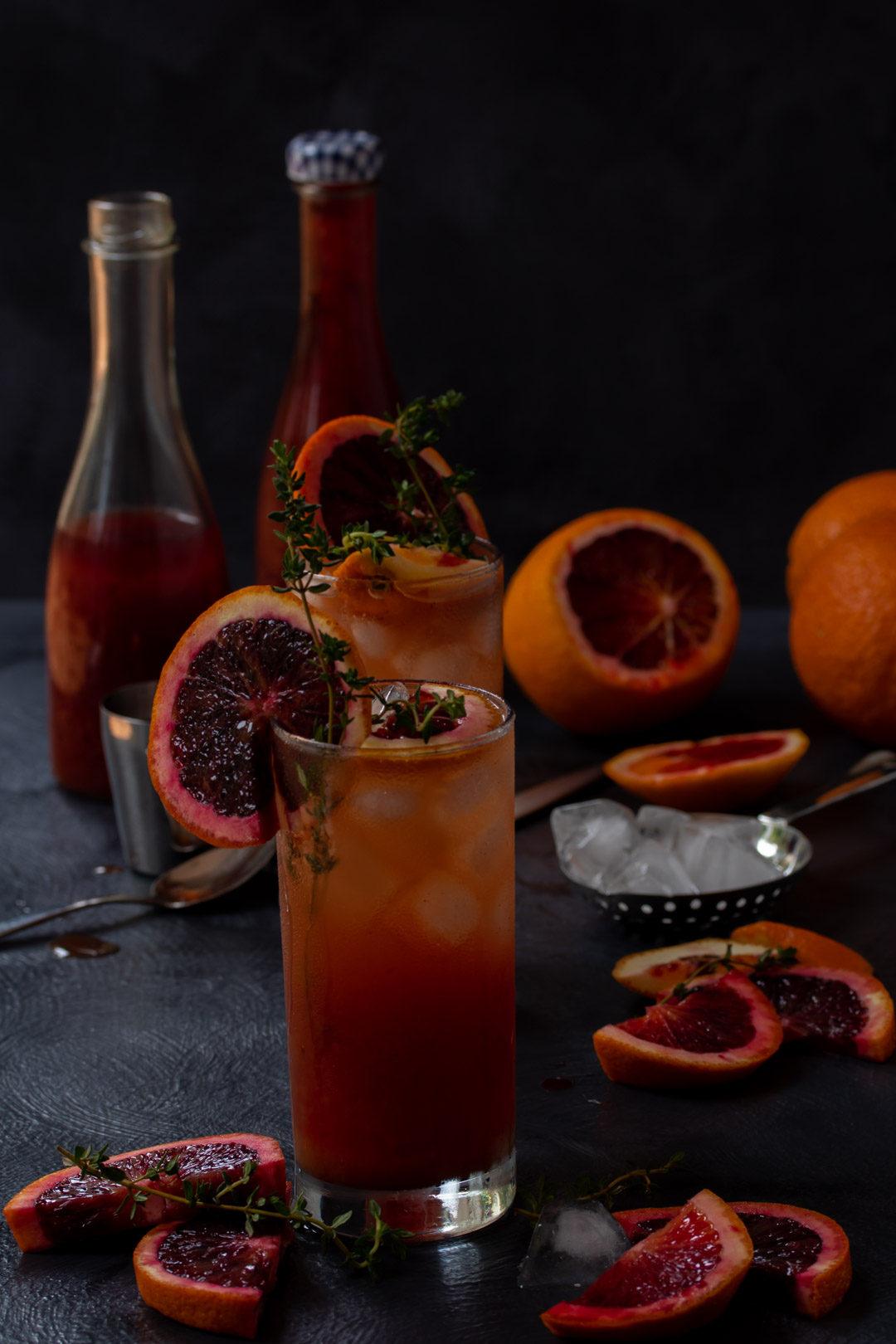 making blood orange and thyme spiced shrub