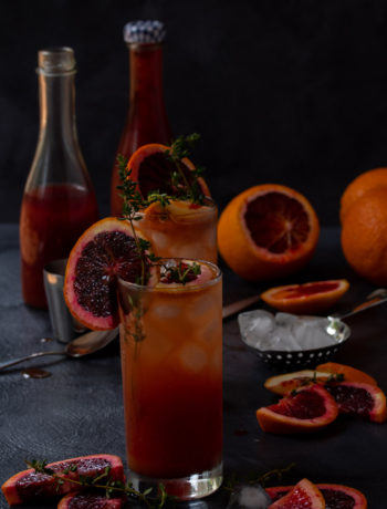 making blood orange and thyme spiced shrub
