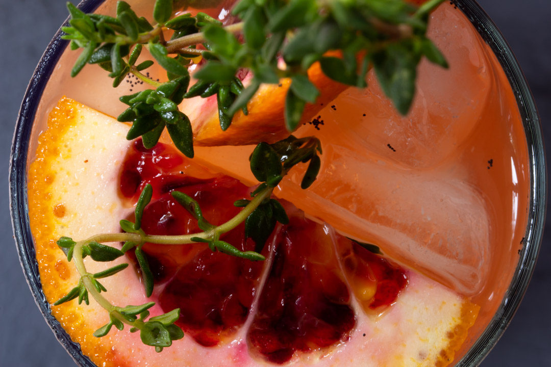 spiced blood orange and thyme shrub close up