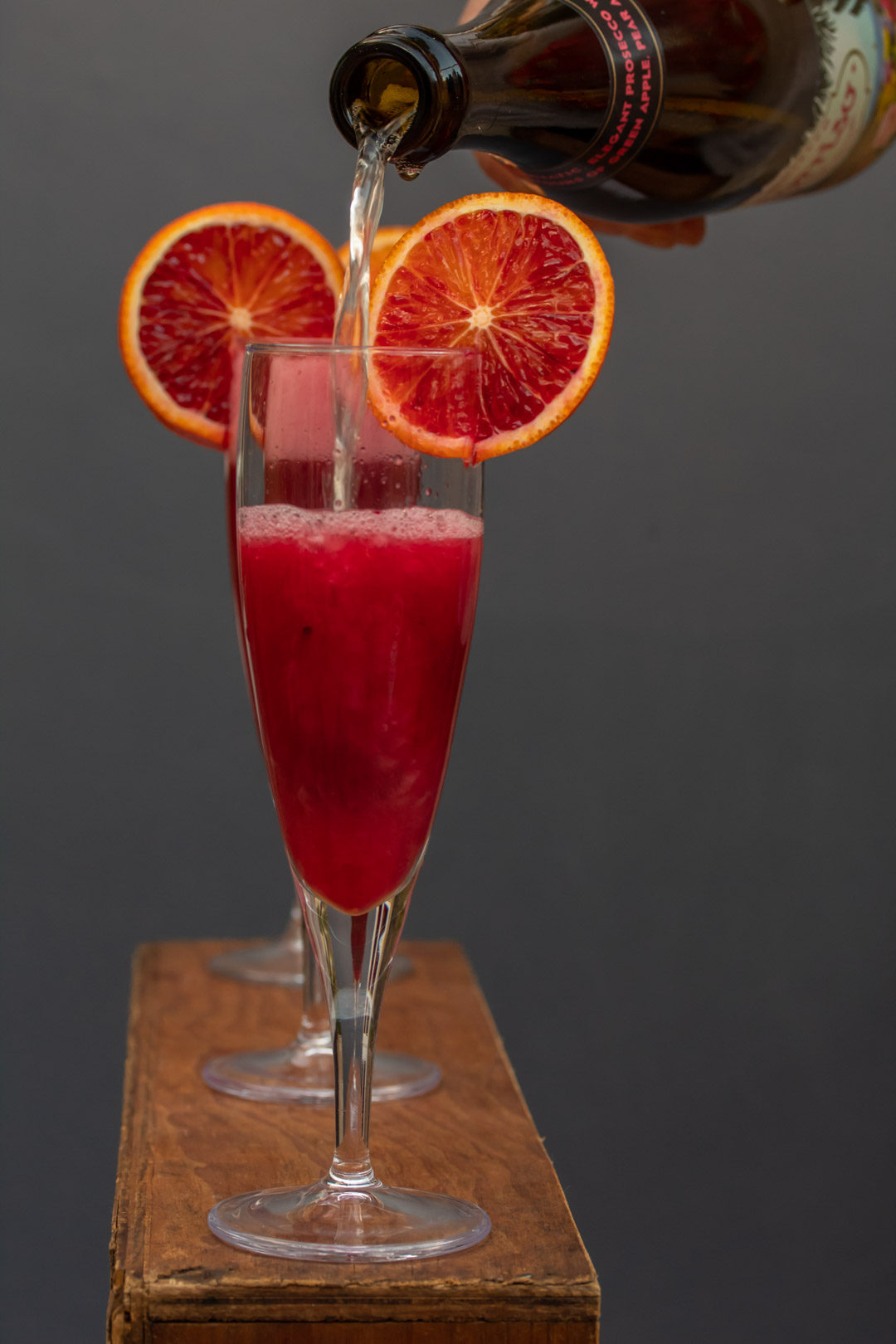 pickled cherry blood orange prosecco pour
