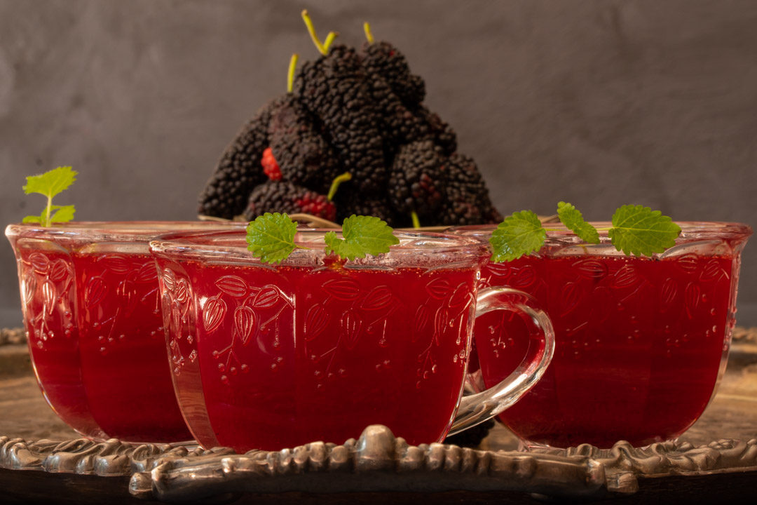 spiced mulberry shrub three glasses