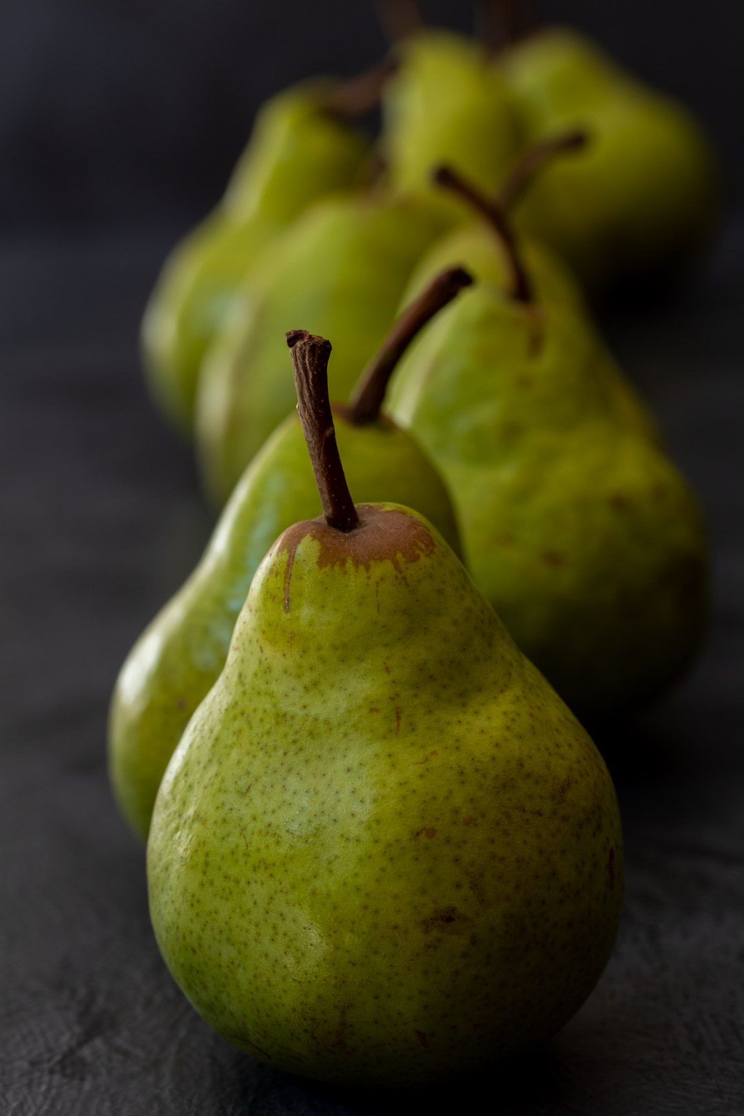 Pear pickles with cardamom & ginger: pears in line still life