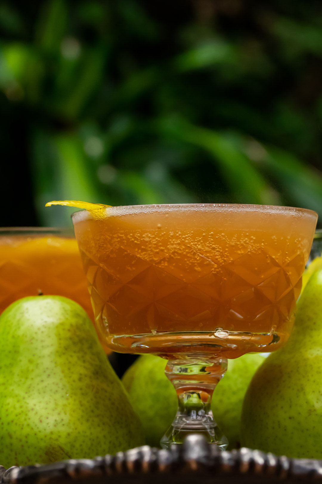 ginger pear champagne cocktail: eye level lemon garnish to left