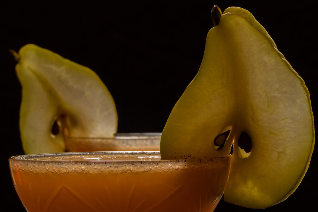 spiced ginger pear shrub: two glasses close up
