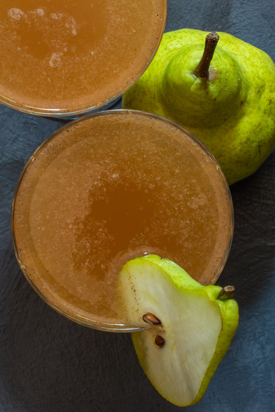 spiced ginger pear shrub: from above two glasses