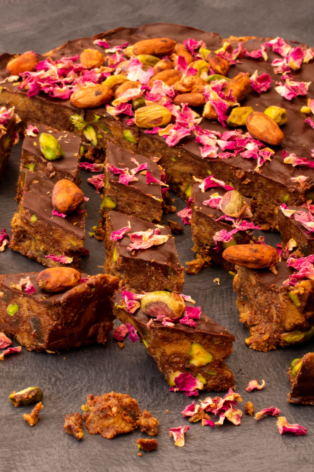 Spiced raw cacao halva with pistachios, ginger, cardamom and rose: cut round