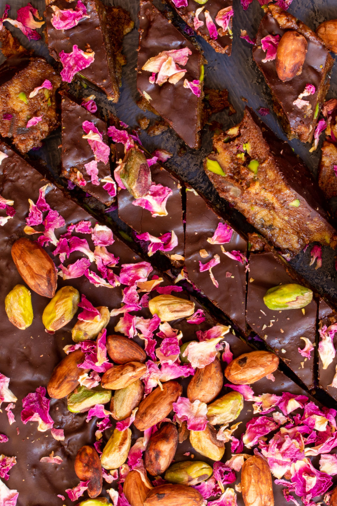 Spiced raw cacao halva with pistachios, ginger, cardamom and rose: cut round from above closer