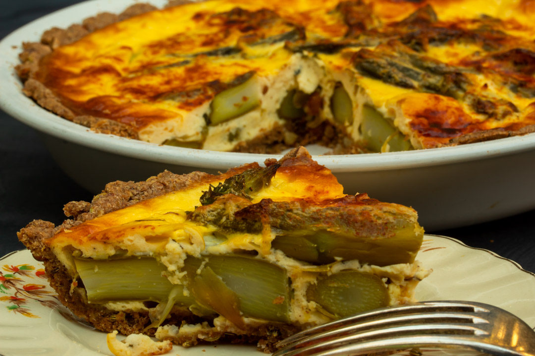 asparagus & lemon tart: slice with whole tart in background