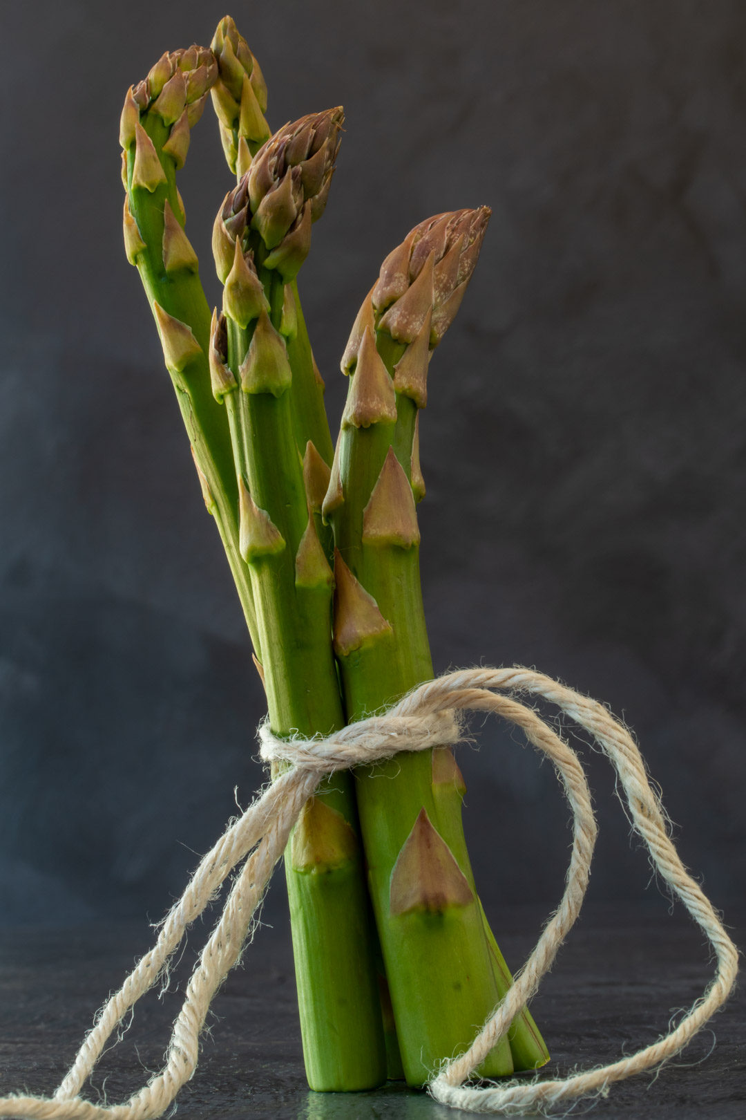 asparagus & lemon tart: asparagus still life with grey background