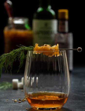 fennel pickle old fashioned cocktail: eye level making vertical